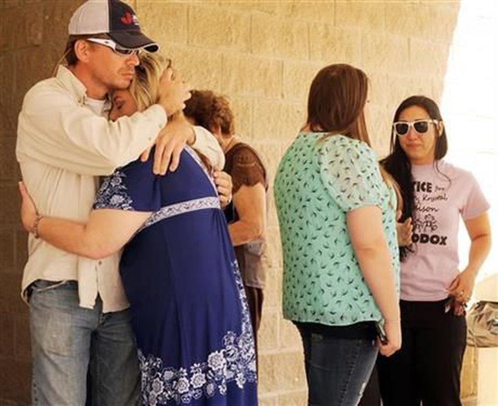 Rhonda Humphus, the mother of murder victim Krystal Maddox, gets a hug from her murdered...