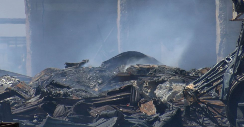 Smoke continues to rise from hot spots Saturday at Dalhart Municipal Airport