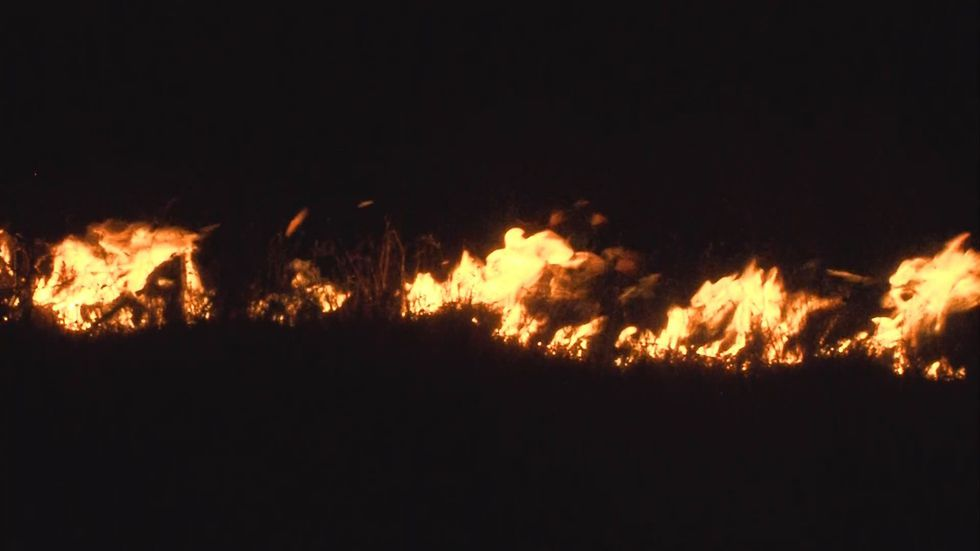 Flames from a fire burning in the middle of the night; Source: KFDA