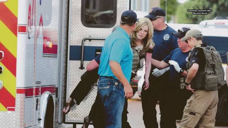 Jessica Thron carried to ambulance during Clovis Carver Library Shooting