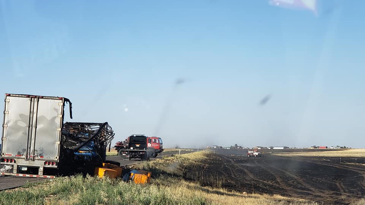 Semi-truck fire turned large grass fire at South Loop 335 and Farmers Avenue