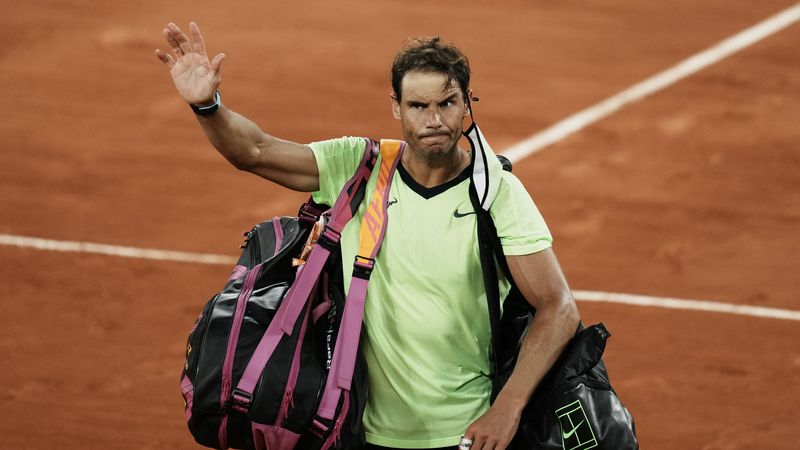 Spain's Rafael Nadal waves to the crowd after losing to Serbia's Novak Djokovic in their...