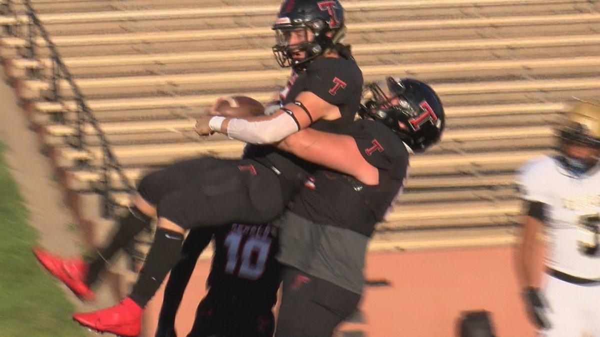 Tascosa lineman lifts up BT Daniel after scoring a touchdown against Abilene High on a...
