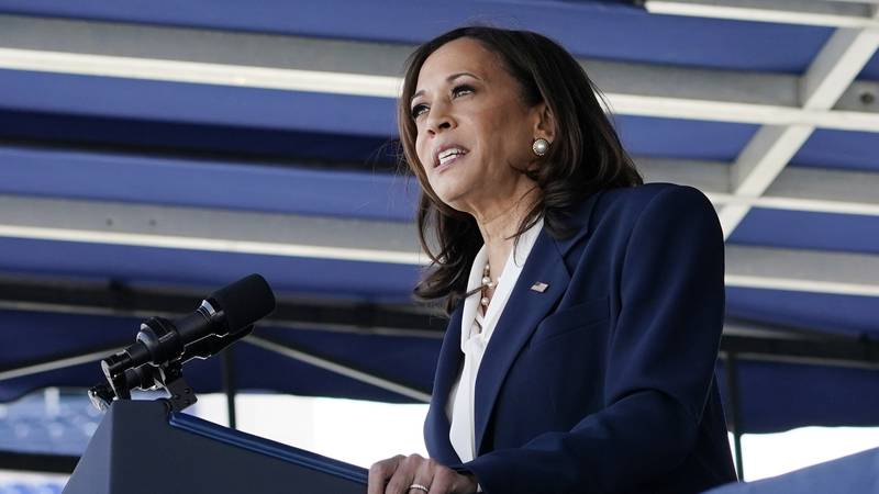 FILE - Vice President Kamala Harris speaks at the graduation and commissioning ceremony at the...