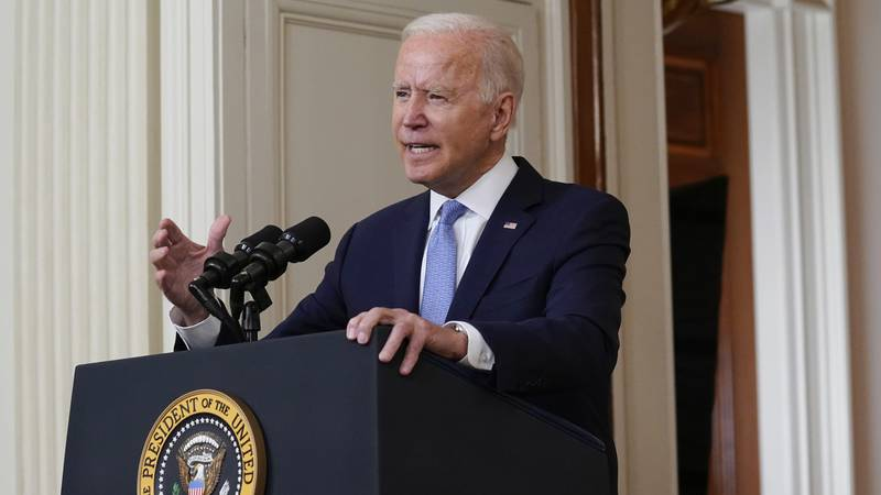 FILE - President Joe Biden speaks about the end of the war in Afghanistan from the State Dining...
