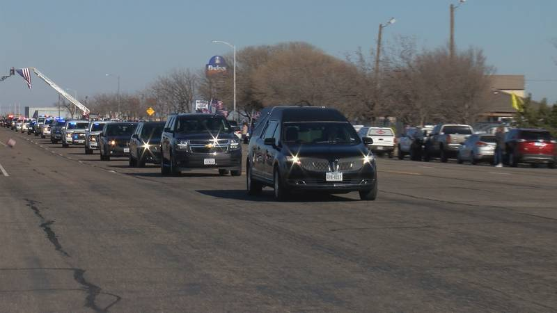 The body of Sgt. Cameron Meddock, killed a week ago in Afghanistan, was escorted through the...